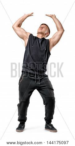 Full body portrait of handsome muscled young man pushing invisible wall under pressure isolated on white background. Self improvement. Healthy lifestyle. Fitness, sport, bodybuilding, workout.