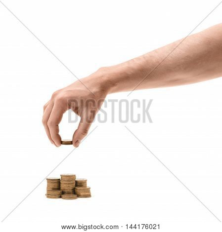 Close up view of a man's hand making stacks of golden coins. Economy and finance. Making money. Treasure up.