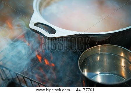 soup with tea heated on charcoal in the summer campaign