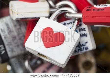 SEOUL SOUTH KOREA - AUGUST 09 2016: Several locks on fence near Namsan Tower as a sign of mutual love. Shot made in Seoul South Korea on August 09 2016
