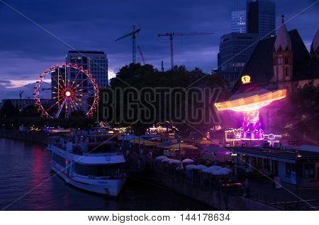 Frankfurt, Germany - August 05: Ferris wheel and rides in Frankfurt's mainfest in 2016