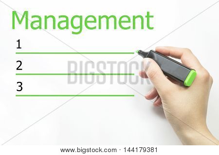 MANAGEMENT blank list, business concept. hand and green marker
