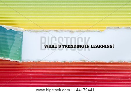 WHAT TRENDING IN LEARNING? question written under torn paper.