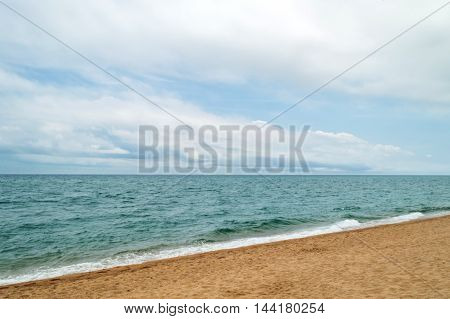 Mediterranean Sea Coast Under Cloudy Sky