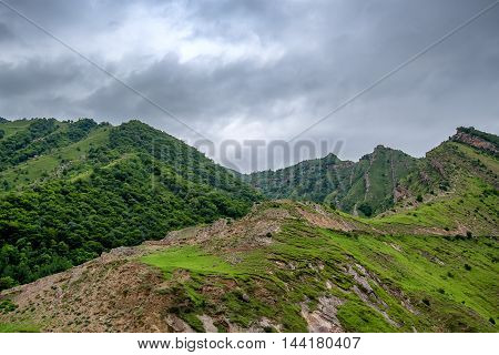 Scenic mountain landscape with aules and dramatic sky