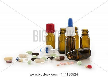pills capsules and pharmacy bottles isolated with shadow on a white background medical concept for health or drug abuse
