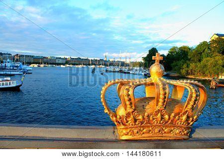 Golden Crown on a Skeppsholmsbron bridge. Stockholm Sweden