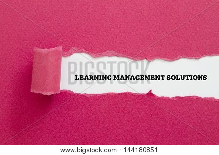 LEARNING MANAGEMENT SOLUTIONS message written under torn paper.