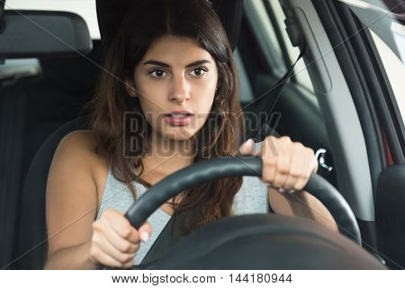 Young Woman Holding Steering Wheel Driving Car
