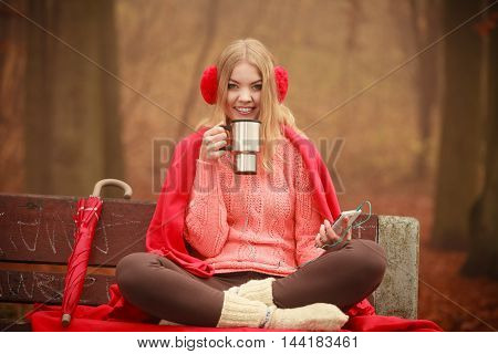 Young Woman Holding Thermal Mug.