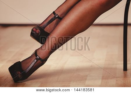 Beauty and sexuality of women. Sexy part body woman model wearing black stockings. Female legs in high heels.
