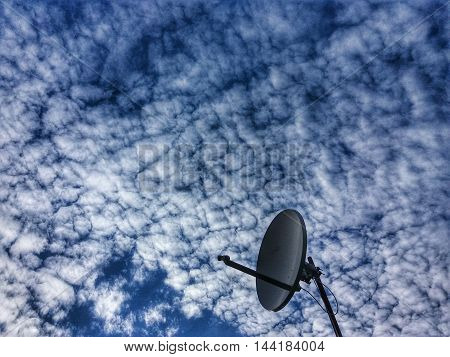 Satellite Dish on interestin cloudy sky background