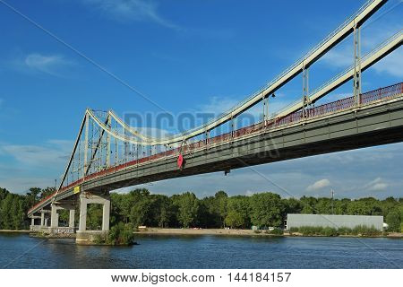Pedestrian bridge leading to Trukhaniv island in Kiev Ukraine
