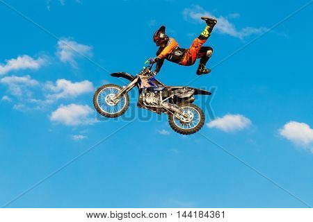 August 6 2016. Ryazan Russia. A professional rider at the FMX (Freestyle Motocross) make an acrobatic jump at the motorshow. Documentary Editorial Image.