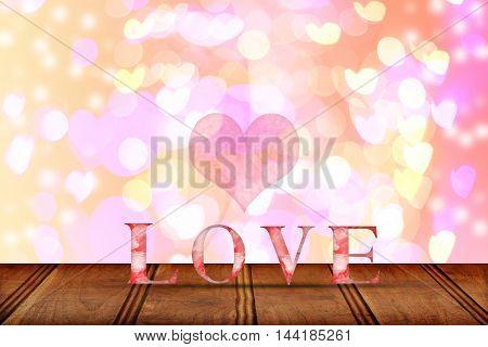 Love word wooden texture on blur bokeh background for valentine's day Valentine's Day Wallpaper
