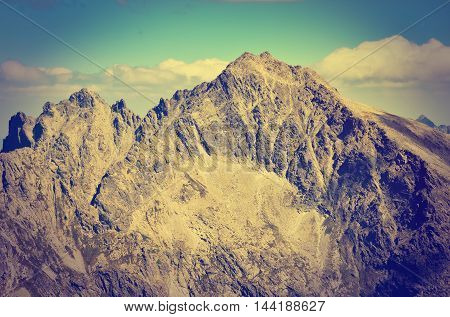 Summer mountain landscape in vintage style. Rocky peaks in High Tatra Mountains in Slovakia.