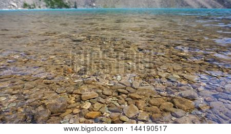 Blue and clear lake see through rocks