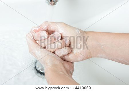 Washing hands with soap under running water. Concept healtcare and medical
