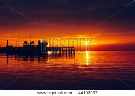Harbor at colorful dramatic sunset in Trieste .