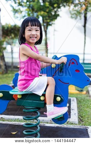 Asian Chinese Little Girl On Seesaw At Playground