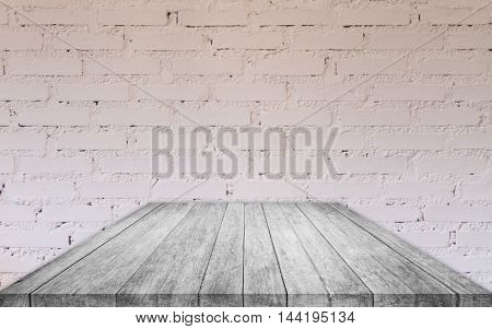Perspective black and white wooden table top with brick wall decorated in coffee shop