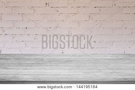Top of black and white wooden table with white brick wall decorated in coffee shop