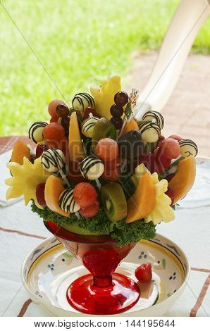 Dessert bowl with pieces of fresh fruits on stick