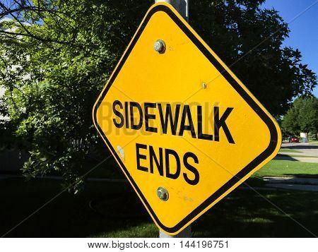 Bright Yellow Diamond Shaped SIDEWALK ENDS sign