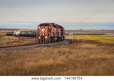 A train charges a hill near Milk River Alberta on its way to the United States.