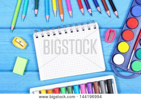 School Accessories On Blue Boards, Back To School Concept, Copy Space For Text In Notepad
