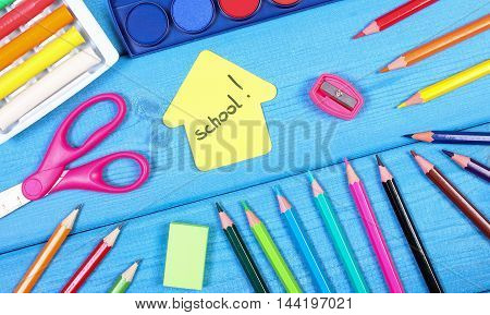 School Accessories And Shape Of Building On Blue Boards, Back To School Concept