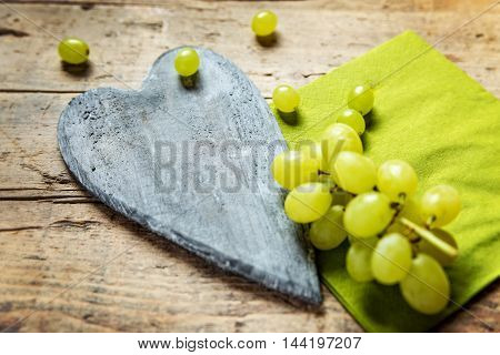 White Wine Grapes On Wooden Table, Wooden Heart With Copyspace