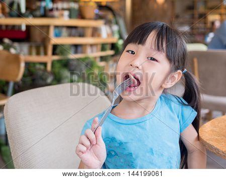 Asian Girl Child Eating American Breakfast