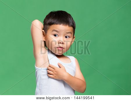Little boy stretching his hand