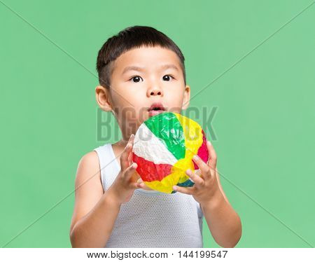 Little boy play with paper ball