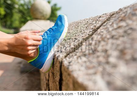 Woman tying laces for jogging