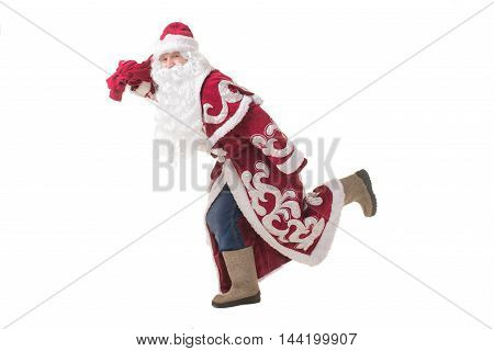 Funny Russian Santa Claus felt boots, wearing a red coat and a bag of gifts