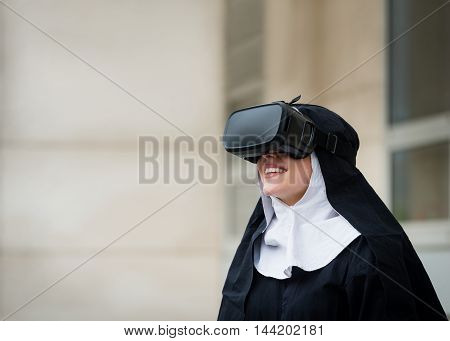 Nun with virtual reality headset - outdoors setting