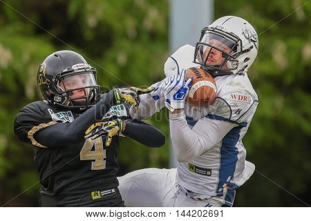 MOEDLING, AUSTRIA - MAY 24, 2015: WR Christian Steffani (#83 Devils) catches the ball in a game of the Division I of the Austrian Football League.