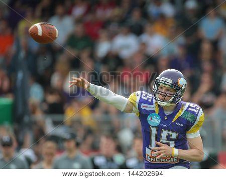 VIENNA, AUSTRIA - MAY 31, 2015: QB Alexander Thury (#15 Vikings) throws the ball in a game of the Austrian Football League.