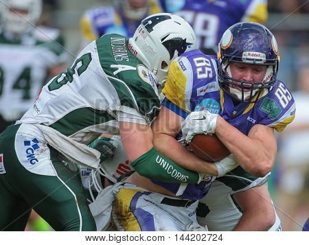 VIENNA, AUSTRIA - MAY 17, 2015: S Cody Pastorino (#6 Unicorns) tackles WR Joey Gabrick (#85 Vikings) in a game of the Big Six Football League.