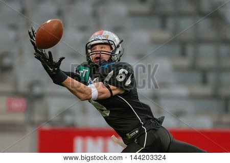 INNSBRUCK, AUSTRIA - MAY 2, 2015: WR Kyle Callahan (#6 Raiders) catches the ball in a game of the Big SIx Football League.