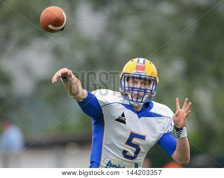 VIENNA, AUSTRIA - MAY 3, 2015: QB Christoph Gubisch (#5 Giants) throws the ball in a game of the Austrian Football League.