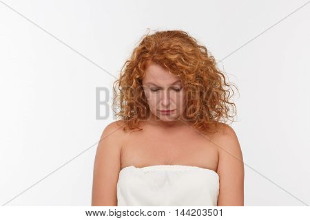 Picture of sad and disappointed mature or middle aged woman posing isolated on white background. Expressing emotions concept.