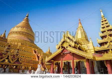 The Great dragon pagoda in Bagan is gilded with gold leaves. It is also called Schwezigon pagoda. Schwezigon is the top destination in Bagan, Manday.