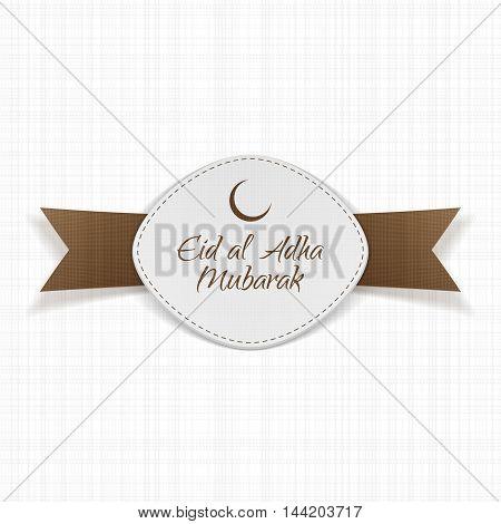 Eid al-Adha Mubarak Label with Ribbon on textile Background