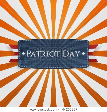 Patriot Day Badge and Ribbon on striped orange Background