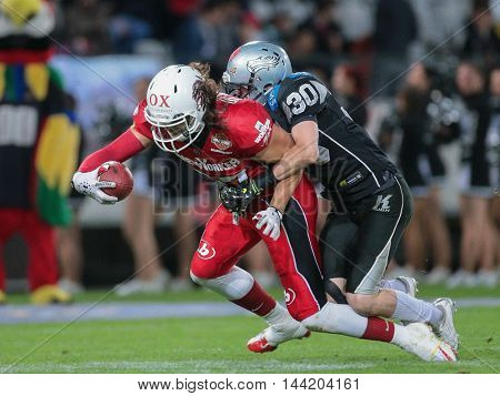 INNSBRUCK, AUSTRIA - MAY 2, 2015: DB Alexander Achammer (#30 Raiders) tackles TE Evan Landi (#87 Lions) in a game of the Big SIx Football League.