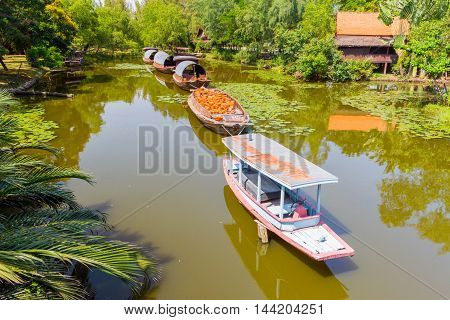 Tugboat on the canal in the Ancient Siam, Thailand