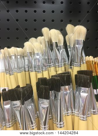 Blurred paint brushes in a stationery store.